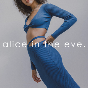 female model wearing a blue long sleeve crop top with midi skirt with alice in the eve text over the top